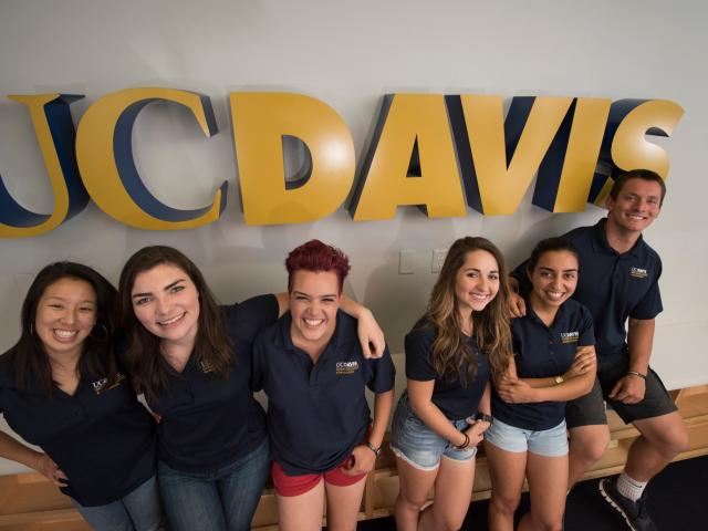Students in front of UC Davis Sign