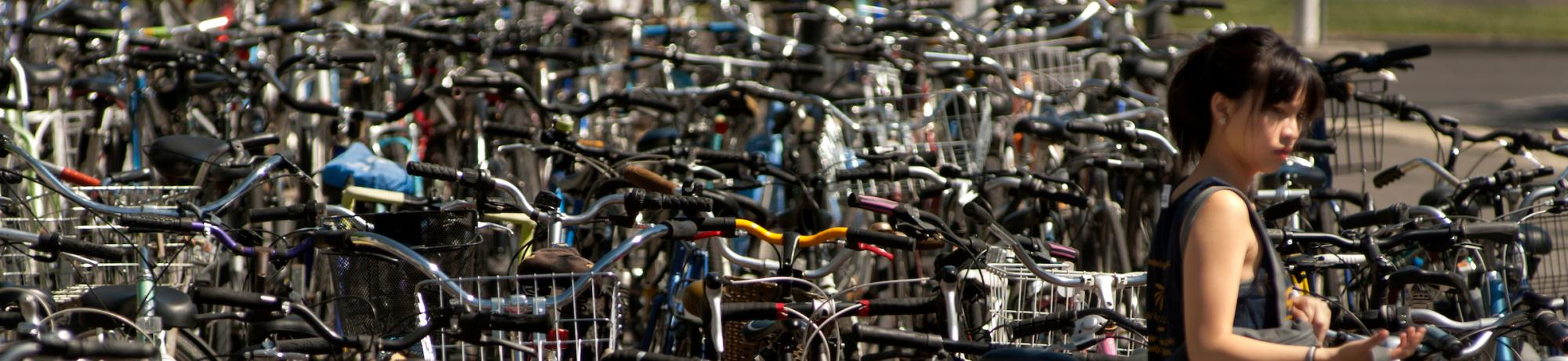 Student Surrounded by Bicycles